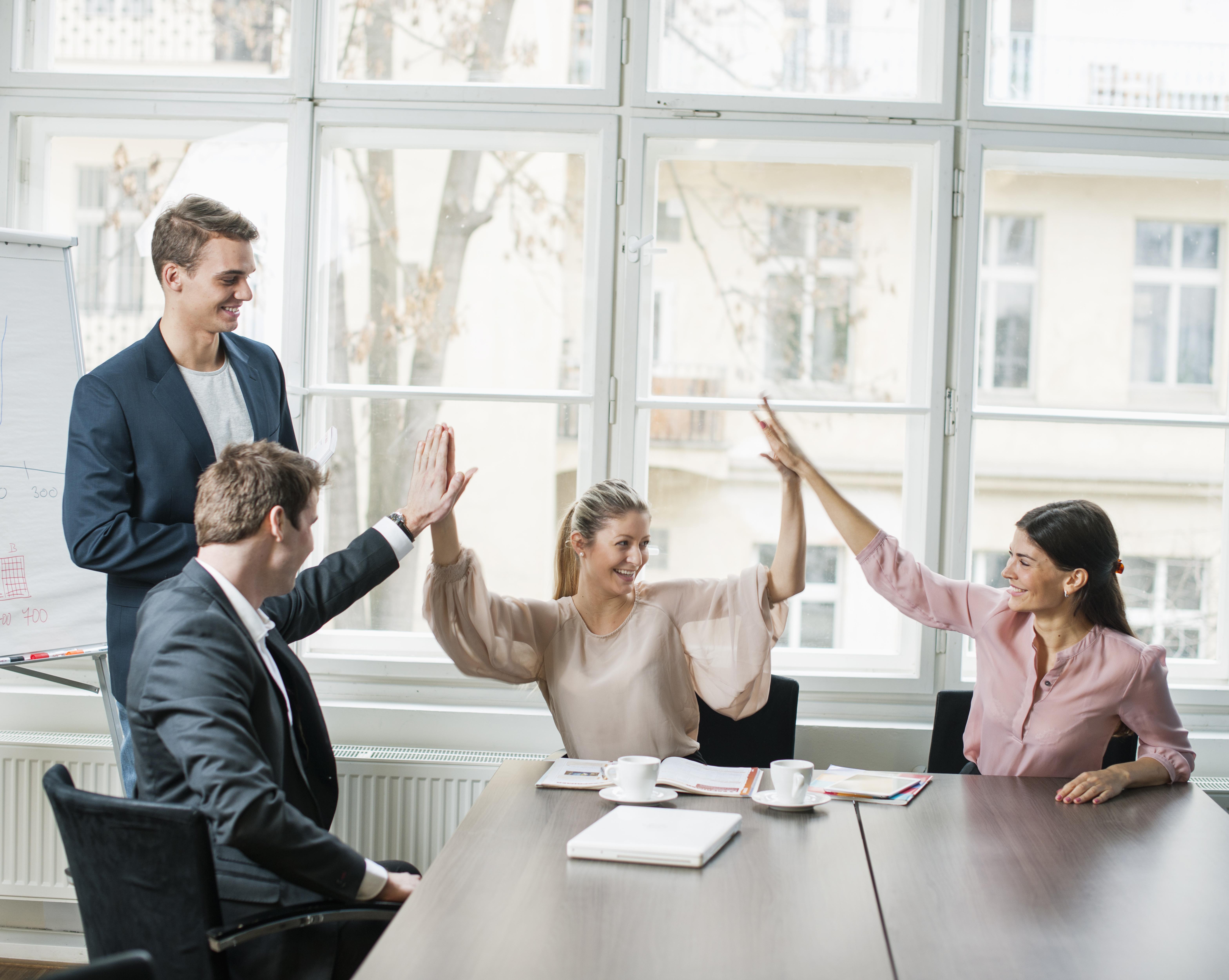 Business Team Doing High Five Meeting Icebreakers